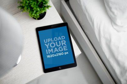 Mockup of an iPad Mini Placed on a Clear Night Table 2211-el