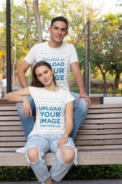 T-Shirt Mockup of a Couple Posing on a Bench 30748