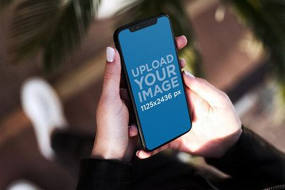 iPhone 11 Pro Mockup Featuring a Woman Holding Her Phone 2129-el1