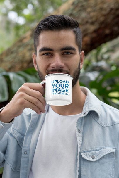 Mockup of a Man Drinking from an Enamel Silver Rim Mug 30809