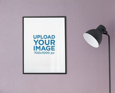 Mockup of a Poster Frame Hanging Next to a Floor Lamp 2021-el1