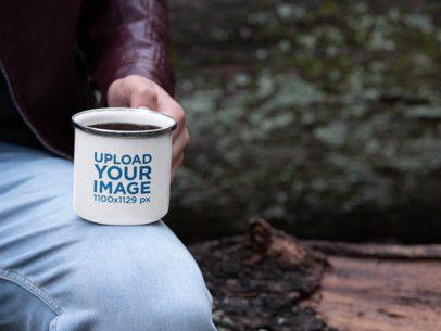 Mockup of a Man Holding a 12 oz Enamel Mug with Silver Rim 30817