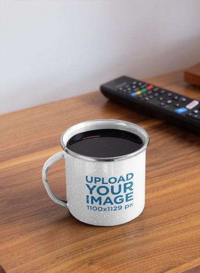 Mockup of an Enamel Silver Rim Mug Placed Next to a TV Remote 30842