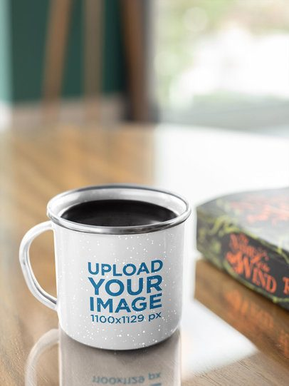 Mockup Featuring a 12 oz Silver Rim Enamel Mug Placed on a Wooden Table 30841