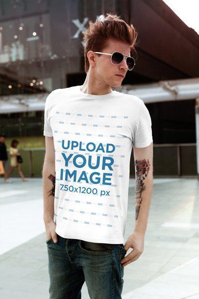 Mockup of a Stylish Man Wearing a T-Shirt at a Mall 2198-el1