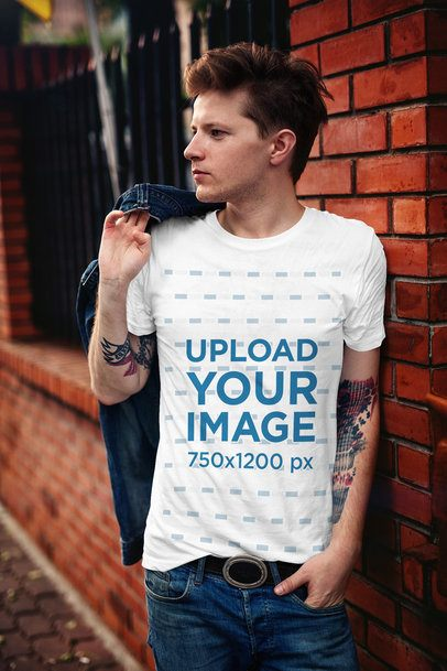 T-Shirt Mockup Featuring a Stylish Man Leaning on a Brick Wall 2199-el1