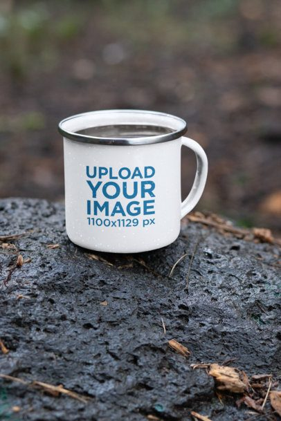 Mockup Featuring a 12 oz Enamel Mug with a Silver Rim Placed on a Rock 30822