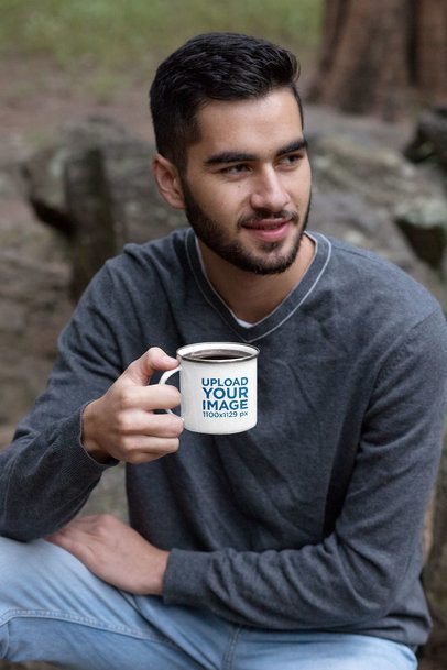 Mockup of a Man Drinking Coffee from a Silver Rim Enamel Mug in the Woods 30813