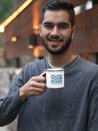 Mockup of a Smiling Man Holding His 12 oz Silver Rim Enamel Mug 30812