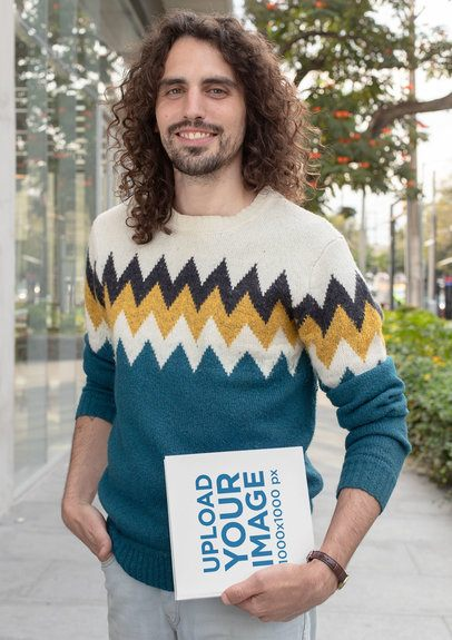 Mockup of a Long-Haired Man Holding a Squared Book 30919