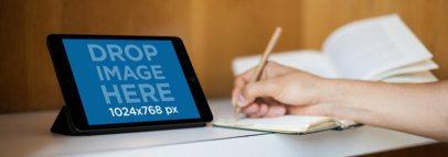 Tablet Mockup of a Student Using a Black iPad Mini a5667