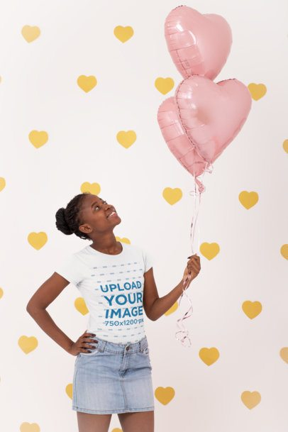 T-Shirt Mockup Featuring a Woman Holding Heart-Shaped Foil Balloons 31211