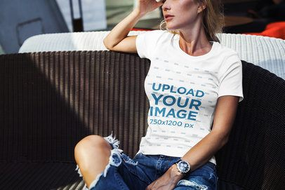 T-Shirt Mockup of a Stylish Woman Sitting in the Sunlight 2229-el1
