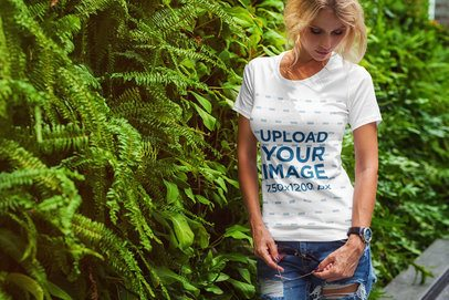 T-Shirt Mockup of a Blonde Woman Posing by a Vertical Garden 2231-el1