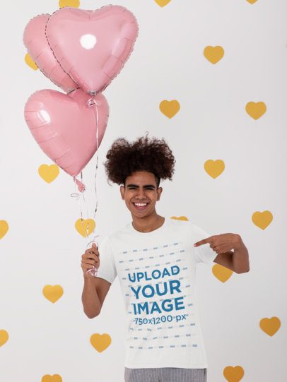 Mockup of a Man Pointing at His T-Shirt and Holding Heart-Shaped Balloons 31226