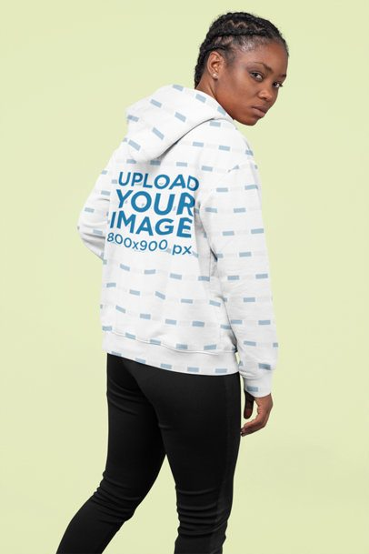 Sublimated Hoodie Mockup Featuring a Woman with Braids Posing at a Studio 31138
