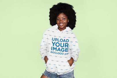 Mockup of a Young Woman Wearing a Pullover Hoodie in a Studio 31142