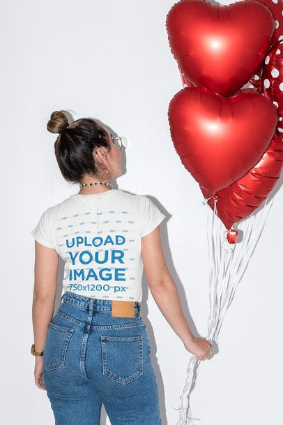 Back-View Mockup of a Woman Wearing a T-Shirt and Holding Heart-Shaped Balloons 31243