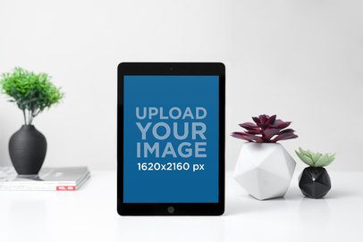 Mockup of an iPad on a Table with Modern Plant Pots 2172-el1