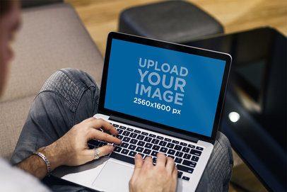 MacBook Pro Mockup Featuring a Modern Man Working 2314-el1