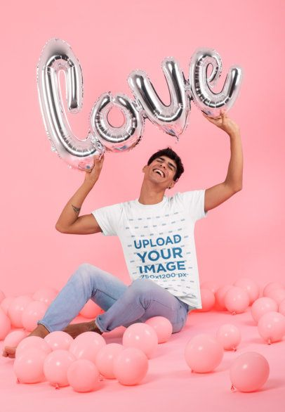 T-Shirt Mockup of a Smiling Man Surrounded by Balloons at a Studio 31205
