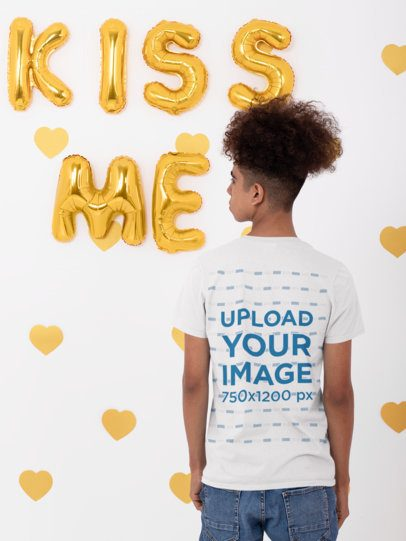 Back View T-Shirt Mockup of a Young Man Posing by Some Letter Balloons 31220