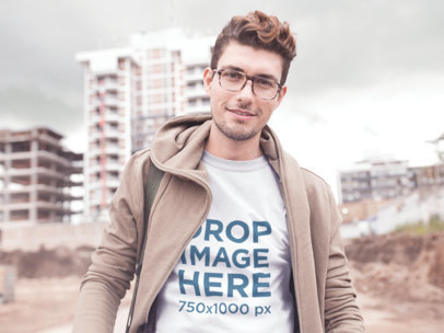Front Tee Mockup of a Young Hipster Near an Urban Scape a11532