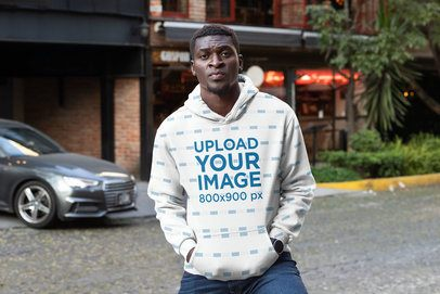 Mockup of a Man Wearing a Sublimated Hoodie in the City 31385