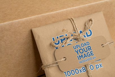 Mockup of a Brand Tag Placed on a Craft-Paper Wrapped Package 1304-el1
