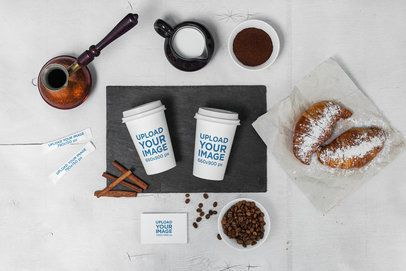Coffee Cup Mockup Featuring Sugar Packets and a Business Card 2180-el1