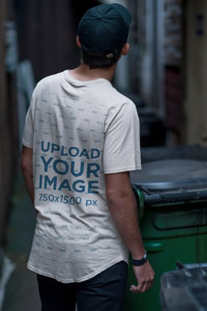 Back View T-Shirt Mockup Featuring a Man in an Alley 2359-el1