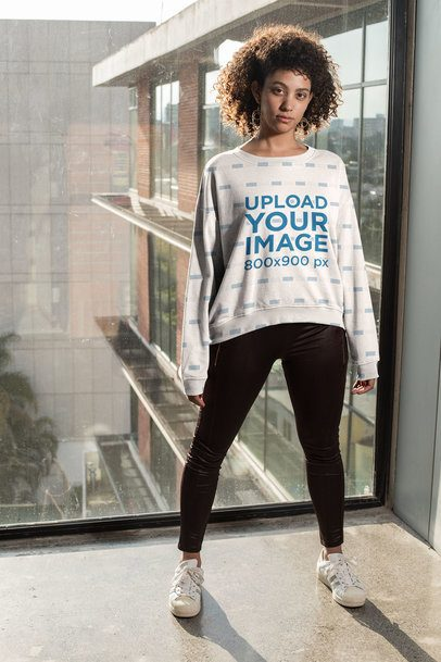 Mockup of a Curly-Haired Woman Wearing a Sublimated Sweatshirt 31157