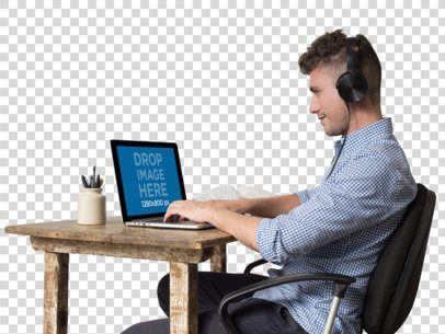 MacBook Mockup Featuring a Young Man Working and Listening to Music a11721