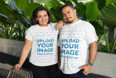 Mockup of Two Friends Wearing Plus Size T-Shirts at a Restaurant 31076