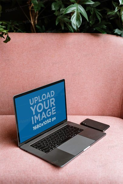 Mockup of a MacBook on a Pink Sofa 2456-el1