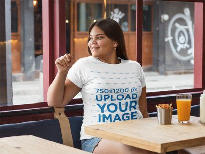 Plus Size Tee Mockup of a Happy Woman in a Cool Restaurant 30905