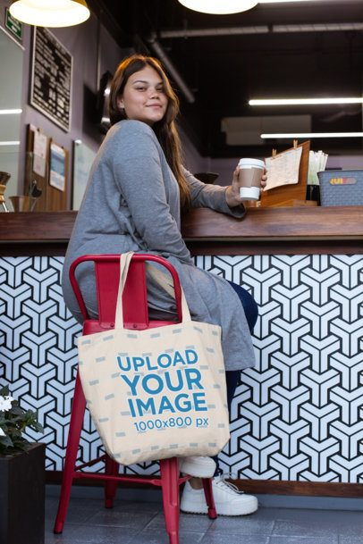 Tote Bag Mockup Featuring a Woman Sitting at a Cafe 30969