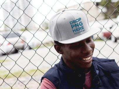 Hat Mockup of a Smiling Black Man Leaning on a Fence 11775