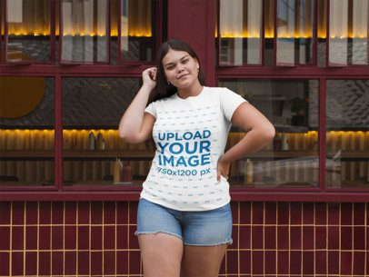 Plus Size T-Shirt Mockup of a Woman Posing Outside a Restaurant 30902