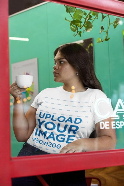 Through-Glass Shot Mockup of a Woman Wearing a Plus Size Tee 30968