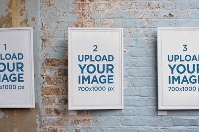 Mockup of Three Poster Frames Against a Worn Wall 2635-el1
