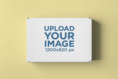 Mockup of a Carton Box Placed on a Customizable Surface 2574-el1