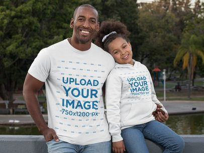 T-Shirt Mockup of a Dad and His Daughter Wearing a Hoodie at the Park 31395