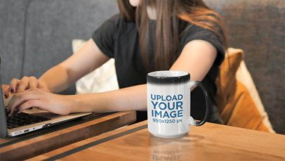 15 oz Coffee Mug Mockup Featuring a Woman Working on Her Laptop 31596