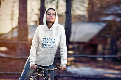 Hoodie Mockup of a Woman Riding a Bike in the Forest 2779-el1