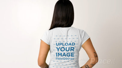 Back View T-Shirt Video Featuring a Long-Haired Woman Posing against a Plain Background 32036