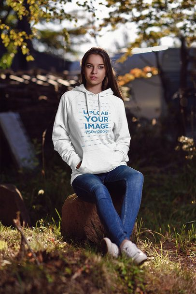 Pullover Hoodie Mockup Featuring a Young Woman Sitting on a Rock 2791-el1