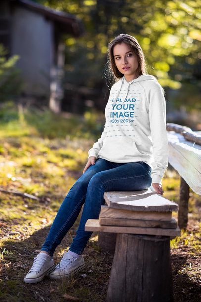 Pullover Hoodie Mockup of a Woman Sitting on a Wooden Bench 2792-el1