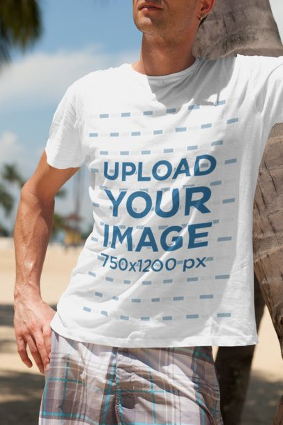 Mockup of a Young Man Wearing a Crew Neck T-Shirt at the Beach 2748-el1