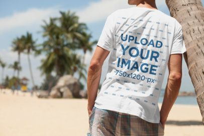 T-Shirt Mockup of a Relaxed Man Leaning on a Palm Tree 2749-el1